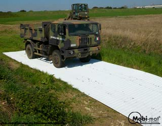 TAMES™: ground improvement mat and roadways